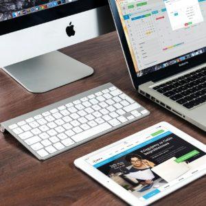 Cnjunto de equipos mac , ipad, macbook y imac con teclado bluethoot